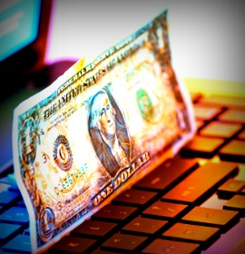 money on keyboard in mixed light