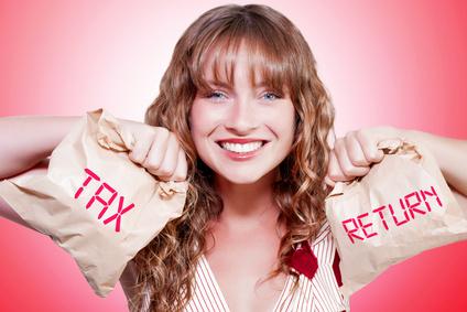 Happy Female Accountant Holding Income Tax Return