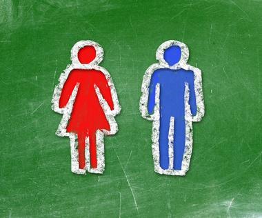 Girl and boy drawn on a chalkboard