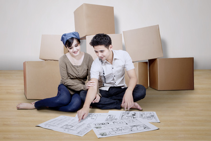 Couple looking at blueprint of new house
