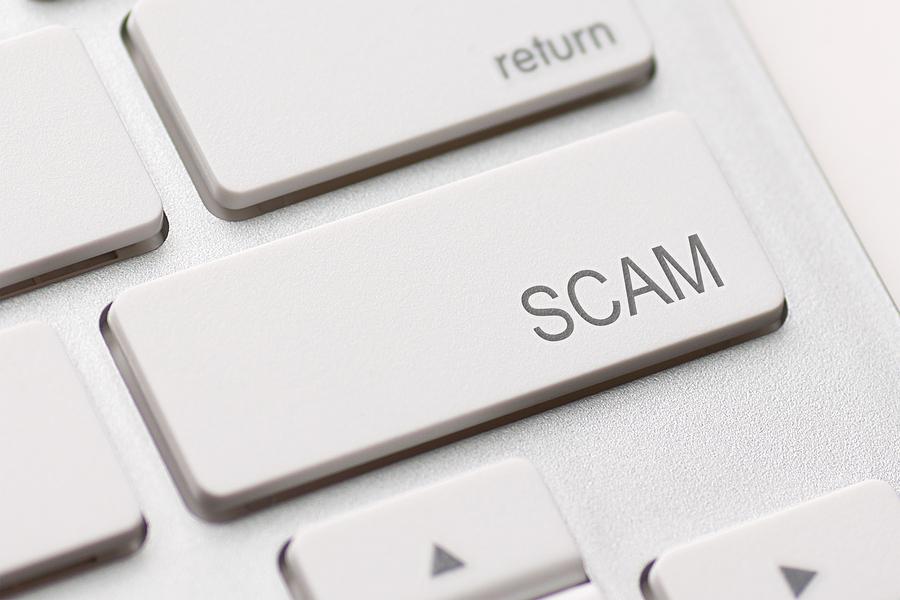 bigstock-Scam-Computer-Key-45876568