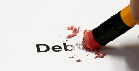 Debt being erased by the end of a pencil, word implies debt