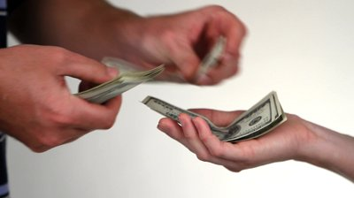 stock-footage-close-up-of-paying-cash-from-man-s-hands-counting-out-one-hundred-dollar-bills-into-a-woman-s-hand