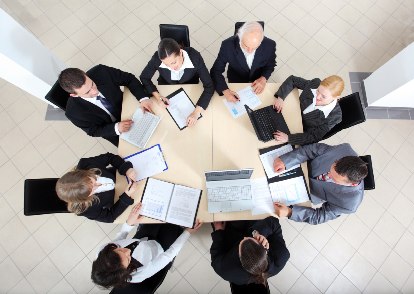 High angle view of business team working on the meeting.