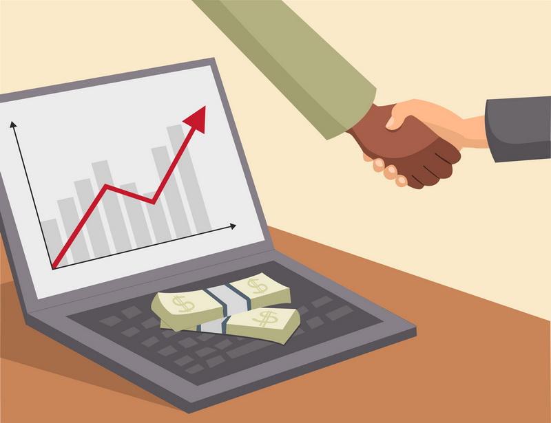 handshake and money on laptop