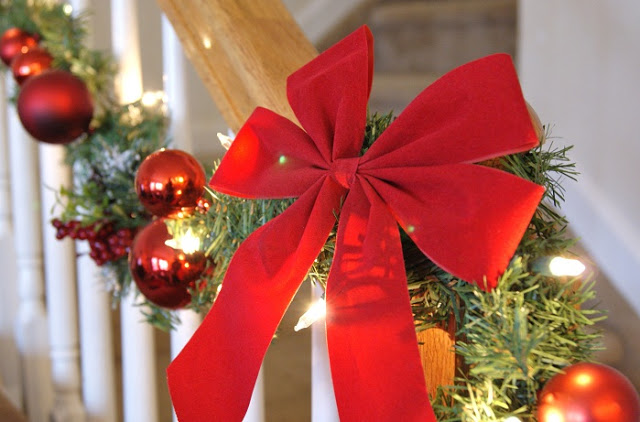 red Christmas garland on staircase