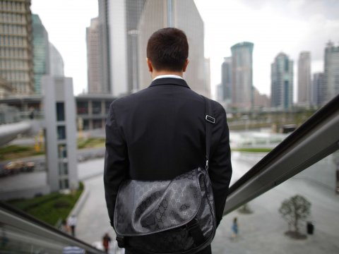 man-suit-buildings